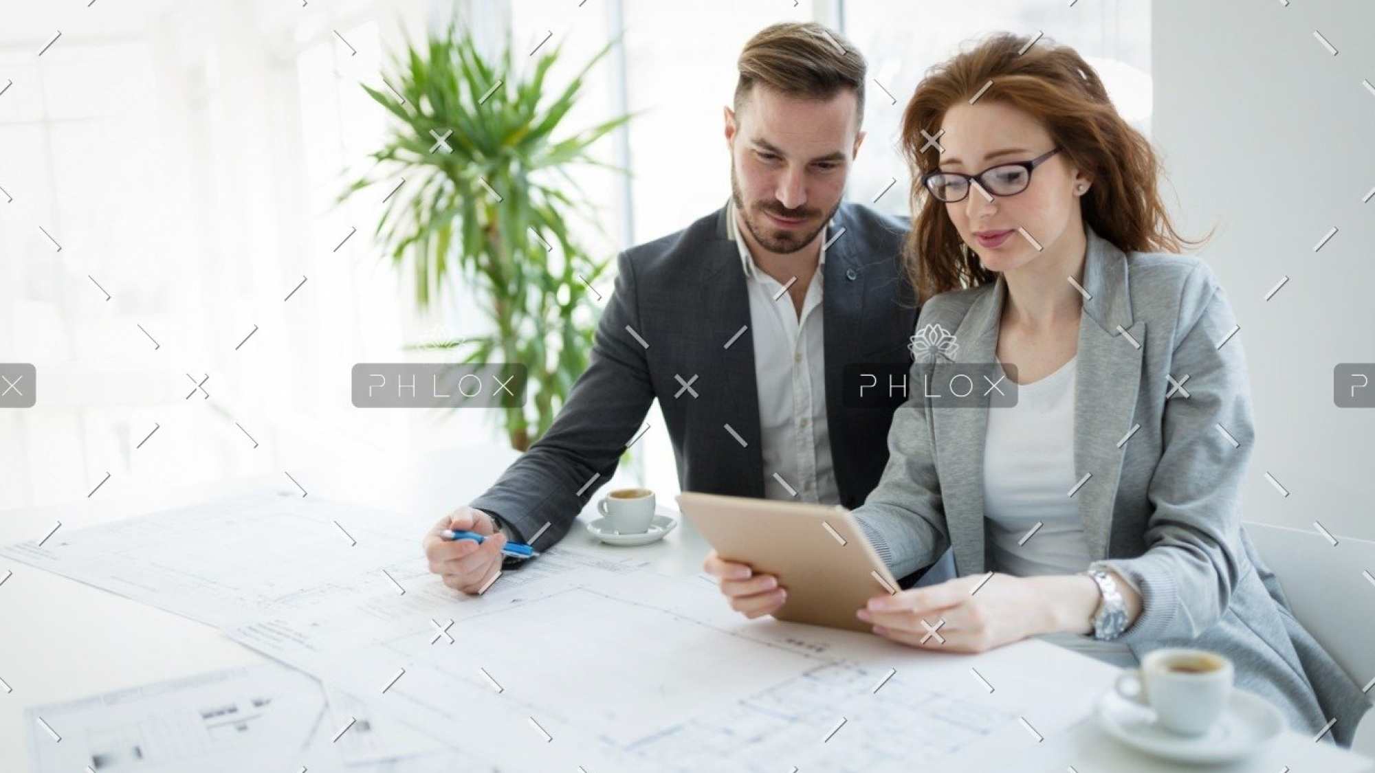 demo-attachment-596-portrait-of-young-architect-woman-on-meeting-KFZCE3A